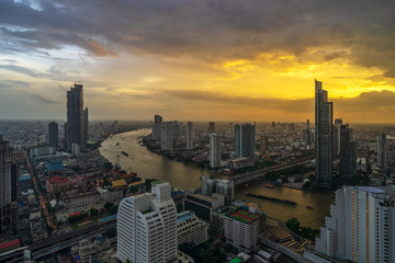 aerial view of sunset cityscape with curve of river