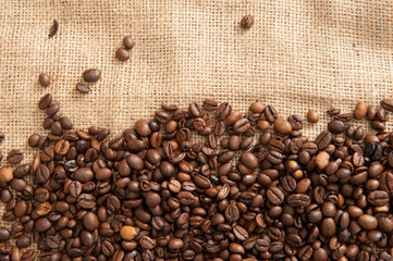 Abstract background with coffee beans on the background of sacking