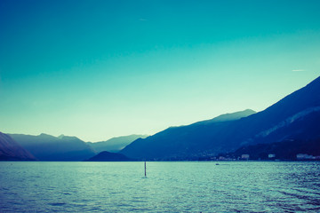 Beautiful Alpine mountains and Como lake at sunset, Lombardy, Italy