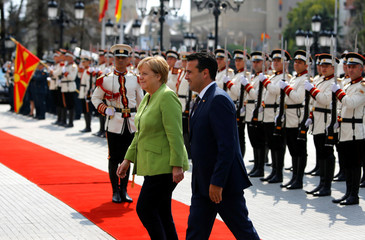 Macedonian Prime Minister Zoran Zaev and German Chancellor Angela Merkel attend a welcome ceremony in Skopje