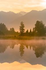 Mirror water lake early morning, Matheson lake New Zealand natural landscape