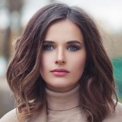 Young beautiful female face closeup, portrait
