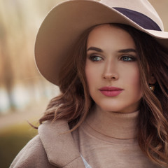 Closeup portrait of young beautiful woman face outdoor