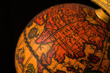 Ancient globe replica with map of East Asia countries on Eastern Hemisphere during the Age of Discovery