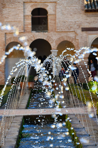 Arabic style water game fountain in palace garden in Granada Spain
