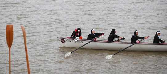 Rowers dressed as nuns take part in the Great River Race on the River Thames in London