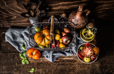 Colorful ,organic ,tomatoes, harvest ,basket , dark, rustic ,kitchen, table , cooking, ingredients,Healthy, food ,concept