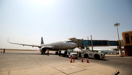Lebanon's Middle East Airlines aeroplane is seen parked on Basra airport after it was targeted by rocket fire in Basra