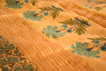 Yellow fabric with traditional floral prints