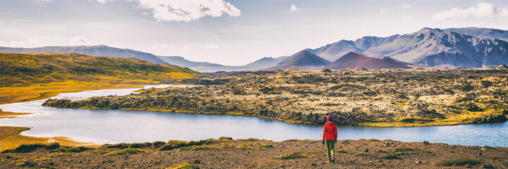Wall Mural - Hiking nature amazing landscape travel wanderlust woman hiker on holiday in Iceland. Panoramic banner hero view of icelandic lake.