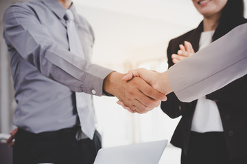 Businessmen shake hands after meeting to show business etiquette.They are congratulating the new management.