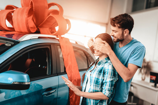 A Guy Presents A Car To Girlfriend. Gift Concept.
