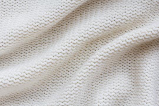 beige knitted fabric  background. reverse stockinette stitch pattern