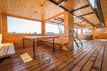 Interior of wooden modern chalet next to river