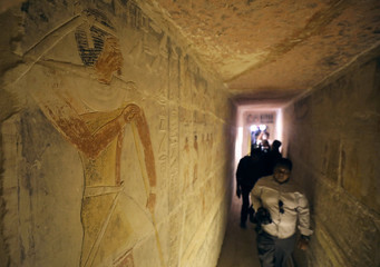 Tourists pass through the entrance of a chamber of the tomb of Mehu after it was opened for the public at Saqqara area near Egypt's Saqqara necropolis, in Giza