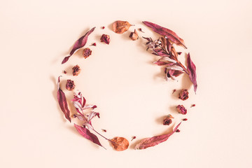 Autumn composition. Wreath made of dried flowers and leaves on pastel beige background. Autumn,...