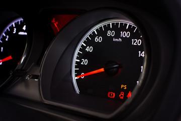 Car speedometer with kilometer per hour.