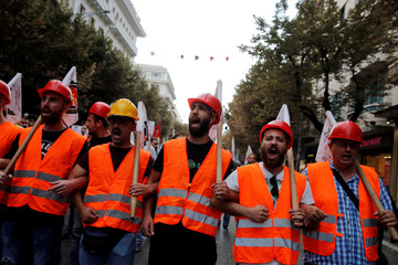 Protesters from the Communist-affiliated trade union PAME shout slogans as they take part in an anti-austerity demonstration during the opening of the annual International Trade Fair of Thessaloniki by Greek Prime Minister Alexis Tsipras in Thessaloniki