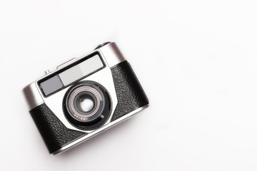 Vintage old photo camera on white background from top