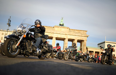 Motorcyclists gather near the Brandenburg Gate as they participate in the Hells Angels demonstration in Berlin