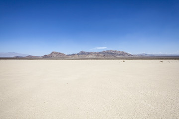 Fotorolgordijn Droogte Silurian dry mud flat lake bed near Death Valley in California's vast Mojave desert.