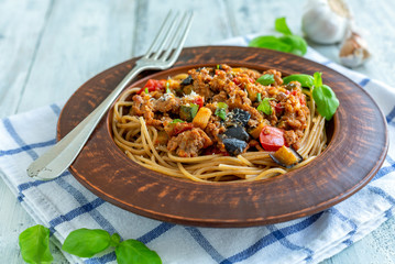 Spaghetti with Bolognese sauce with zucchini and eggplant.