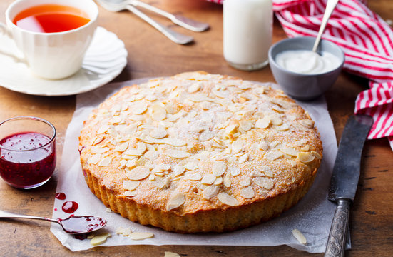 Almond and raspberry cake, Bakewell tart. Traditional British pastry. Wooden background.
