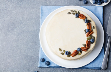 Vegan, raw carrot cake. Healthy food. Grey stone background. Top view. Copy space.
