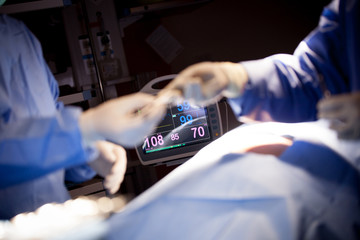 Heart monitor measuring vital signs. heart rate monitor in hospital theater