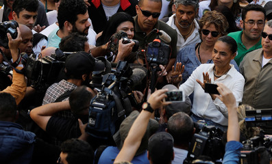 Presidential candidate Marina Silva of the Brazilian Sustainability Network Party (REDE) gestures to photojournalists and cameramen during a campaign rally in Sao Paulo