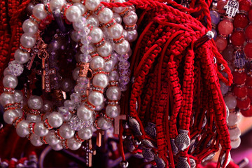 Bracelet braided from red thread and pearls. amulet against the evil eye on the wrist from Jerusalem, Israel