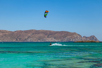 Kite surfer at famous Elafonisi beach in southern Crete, Greece.