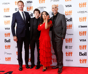 Actors Alexander Skarsgård, Jesse Eisenberg and Salma Hayek pose with director Kim Nguyen at the world premiere of The Hummingbird Project at the Toronto International Film Festival (TIFF) in Toronto