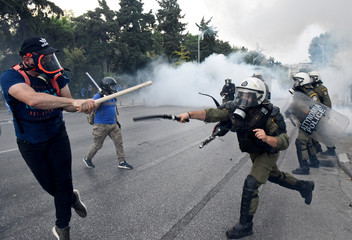 Protesters clash with police during a demonstration against the agreement reached by Greece and Macedonia to resolve a dispute over the former Yugoslav republic's name, during the opening of the annual International Trade Fair of Thessaloniki