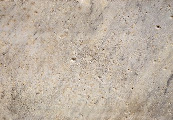 Antique natural marble background. Scratched and weathered texture.