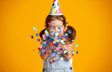 Foto op Aluminium Carnaval happy birthday child girl with confetti on yellow background