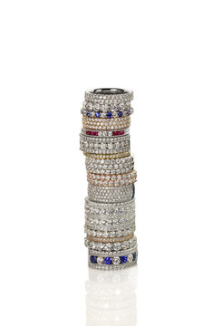 Diamond gemstone rings stacked together bridal wedding and engagement setting isolated on white