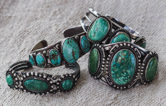 Four antique Navajo silver and turquoise bracelets