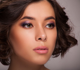 Macro photo of woman face with professional makeup and haircuts. CloseUp