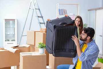 Young family with suitcase in relocation concept