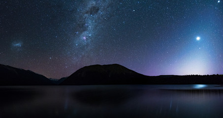 Panorama, Amanzing Starry night at Lake Rotoiti. Reflection of the Milky way and galaxy on the lake. Nelson Lake National Park, New Zealand. High ISO Photography.