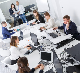High-angle view of business people working and communicating together