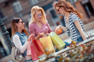 Group of shopping women looking very happy