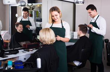 Blonde cuts hair at salon