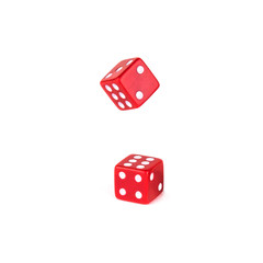 Two red dice isolated on white background. One dice still falls