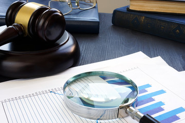 Financial crime. Gavel and Magnifying glass with business documents. Fraud. - fototapety na wymiar