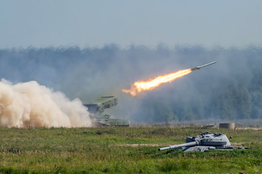 Launching military rockets in the woodlands, war shot defense attack.