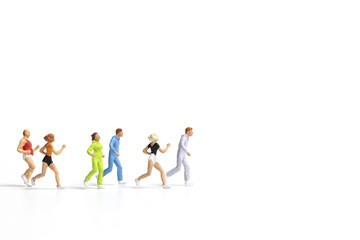 Miniature people running on white background , Healthy lifestyle and sport concepts.