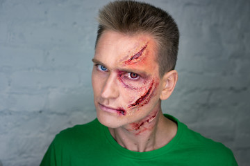Professional make-up of young man with horrible scars