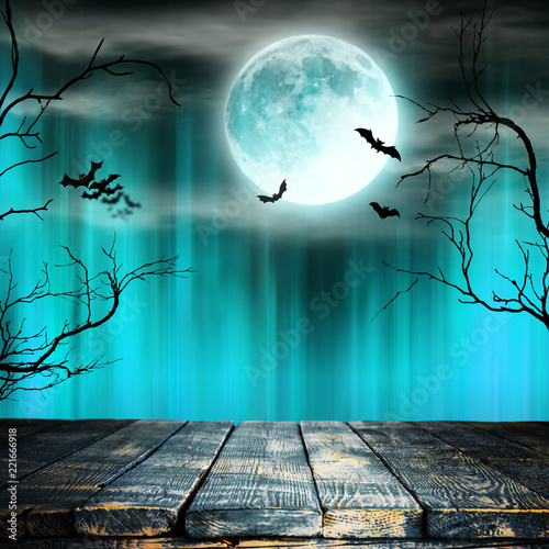 Spooky Halloween background with old trees silhouettes.